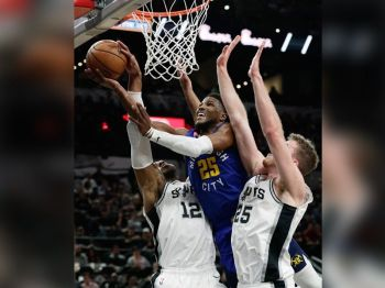 Denver Nuggets guard Malik Beasley (25) drives to the basket between San Antonio Spurs center LaMarcus Aldridge (12) and center Jakob Poeltl (25) during the first half of Game 6 of an NBA basketball playoff series, Thursday, April 25, 2019, in San Antonio. (AP Photo)