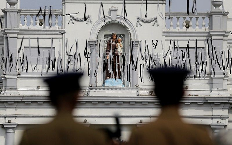 Sri Lankan police officers secure the area of exploded St. Anthony's Church on Easter Sunday attacks in Colombo, Sri Lanka, Sunday, April 28, 2019. Sri Lanka's Catholics on Sunday awoke preparing to celebrate Mass in their homes by a televised broadcast as churches across the island shut over fears of militant attacks, a week after the Islamic State-claimed Easter suicide bombings. (AP Photo)
