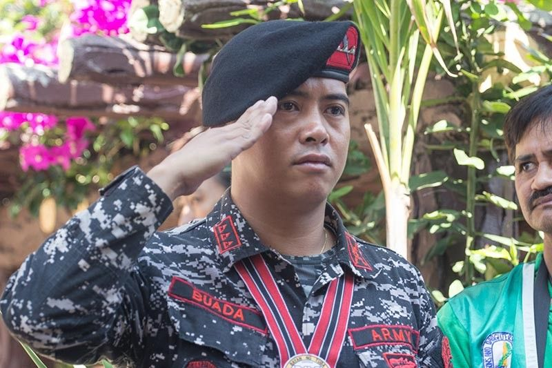 Captain Jeffrey Buada, the Igorot soldier known for his heroism during the last days of Marawi Siege in 2018, goes back to his home town to join the family of fallen war veterans during Tuba's 74th Liberation Day laying flower and wreaths at the Veterans Memorial Shrine in barangay Poblacion on April 26. (Photo by Jean Nicole Cortes)
