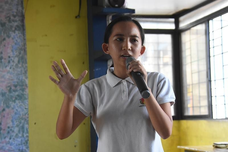 Tambayan Center for Children's Rights monitoring, evaluation, and communications officer Neem Danrelle Cahoy delivering her speech. (Ralph Llemit)