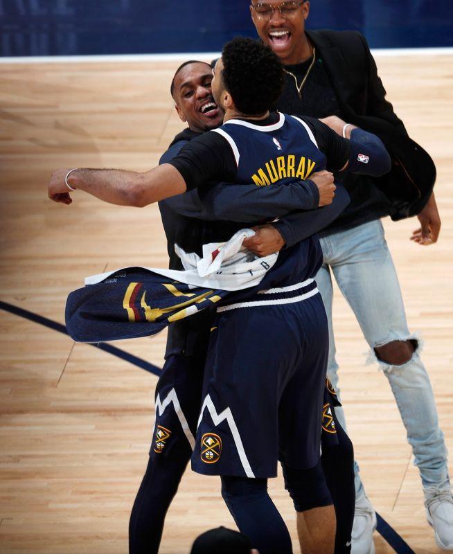 2ND ROUND: Naggakos sila si Denver Nuggets guard Jamal Murray ug Monte Morris agi'g pagsaulog human nila nabuntog ang San Antonio Spurs, 90-86, sa deciding Game 7 sa ilang 1st round NBA Playoffs series kagahapon. (AP)