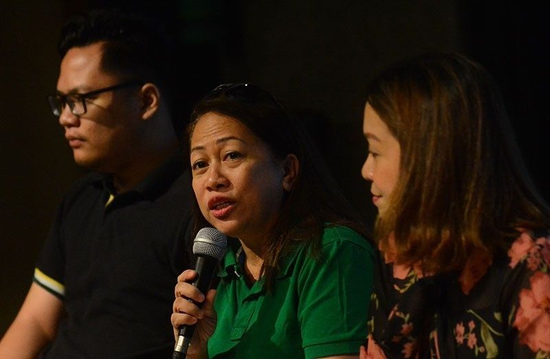 CEBU. San Fernando Mayor Neneth Reluya (center) and her son Ricci (left, in glasses) in Klarohay Ta! candidates' forum at the University of San Carlos downtown campus. With them is Cordova Mayor Therese Sitoy Cho. (SunStar Photo/Amper Campaña)