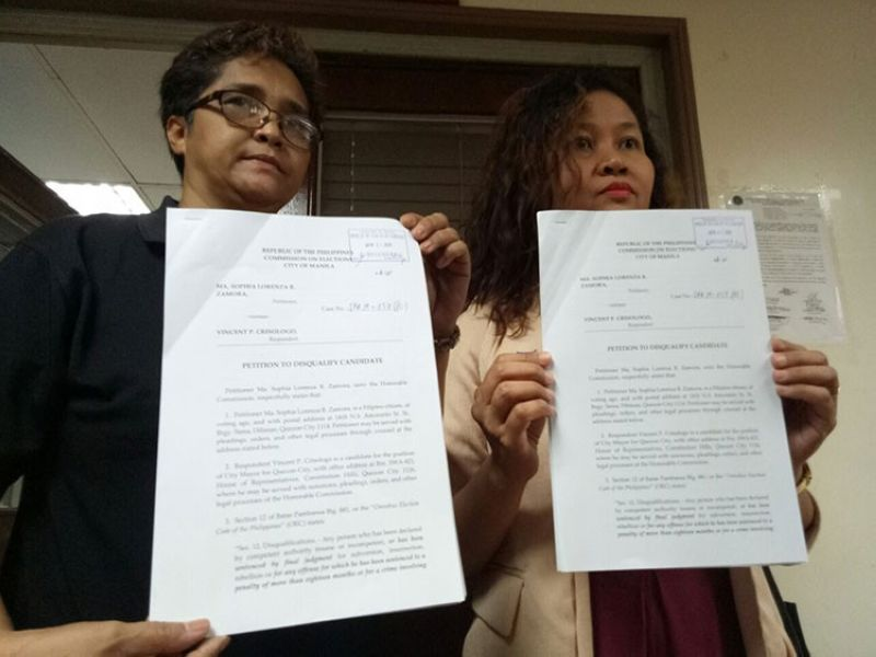 MANILA. Petitioner Sophia Lorenza Zamora (left) and her legal counsel, Atty. Socorro Nepomuceno (right), show copies of the disqualification petition filed against Quezon City mayoral bet Vincent