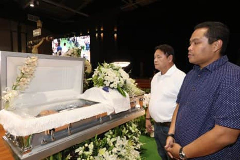 PAMPANGA. Mabalacat City Vice Mayor Christian Halili and former Mayor Marino 'Boking' Morales offer a prayer to the late LGC Chairman Levy P. Laus during Monday's viewing at the Laus Group Event Center. The internment will be today (Tuesday) at the Sanctuario de San Fernando Memorial Gardens, CSFP. (Chris Navarro)