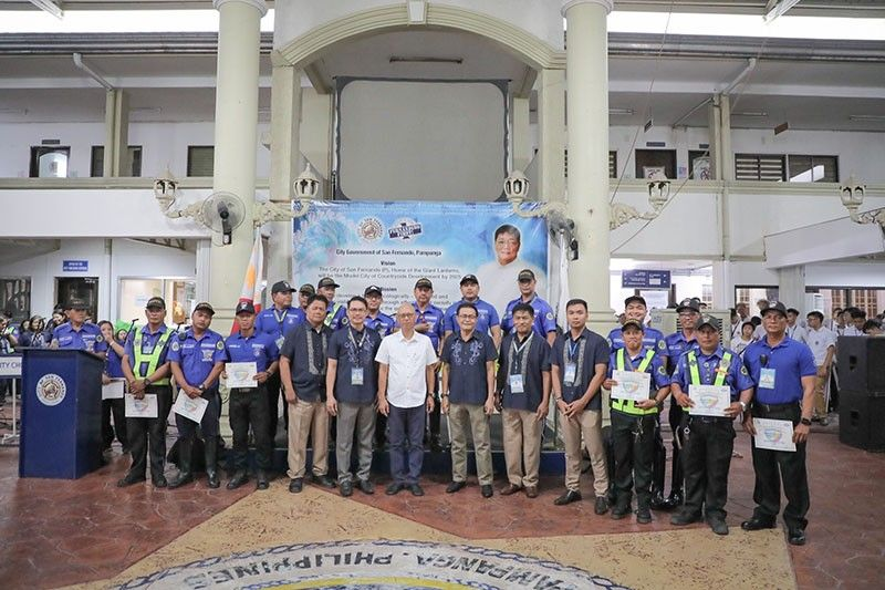 PAMPANGA. Vice Mayor Jimmy Lazatin and CPOSCO Head Raymond del Rosario lead the awarding of the Enforcers of the Month held at the City Hall recently. (Contributed photo)