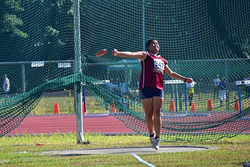 DAVAO. Khessie Jane Baluyot of Digos City gives her best effort to win Davao Region's first medal yesterday in secondary girls discus throw event of the Palarong Pambansa 2019 at the University of Mindanao (UM) track oval in Davao City. (Macky Lim)