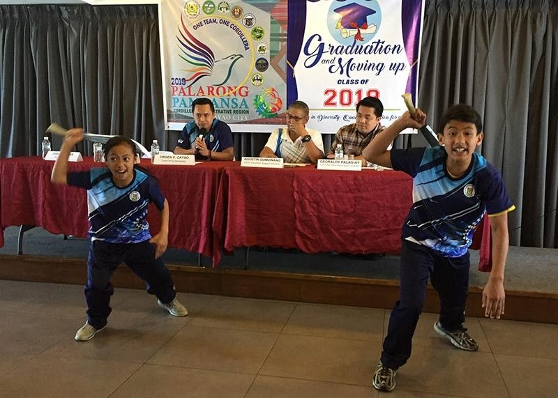BAGUIO. Two arnis players seeing action in the Palarong Pambansa gives a demo during a recent press conference in Baguio City. Arnis gave the Cordillera region its first medal in the weeklong competition backed by the Department of Education. (Carlito Dar)
