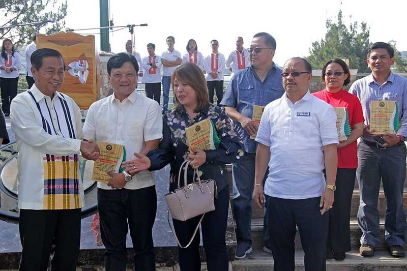 BAGUIO. City officials, headed by Mayor Mauricio Domogan, present the plaques of recognition to top real property and business taxpayers in the city last year who significantly contributed in improving the financial condition of Baguio. (Bong Cayabyab)