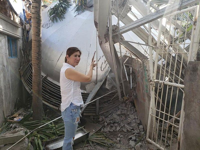 PAMPANGA. Vice mayoralty candidate Angie Hizon inspects the damage to the water tank of Barcelona Subdivision in the City of San Fernando. (Contributed Photo)