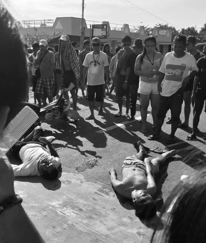 CEBU. Kim Del Mar (right), a Sangguniang Kabataan (SK) councilor from Barangay Malubog in Cebu City, is found lying on the road after he was accidentally hit by a motorcycle driven by Rommel Dakay. Del Mar, 21, is now currently at a public hospital in Cebu City, recuperating from his injuries. (Contributed foto)