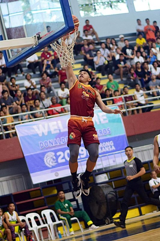DAVAO. Davao Region's Vince Petdeo Cuajao dunks against Bangsamoro Autonomous Region (Barmaa) in their secondary boys basketball game held Monday at the University of Southeastern Philippines (Usep) Gym in the ongoing Palarong Pambansa 2019. Davraa won this one, 110-60. (Koii Canarias)