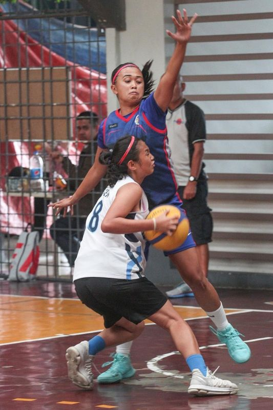 BAGUIO. Team Fast Track's Zhalyn Mateo tries to stop Fidela Angayen of Team San Vicente during the third leg of a 3x3 basketball tournament on April 27 at St. Vincent Gym. (Photo by Jean Nicole Cortes)