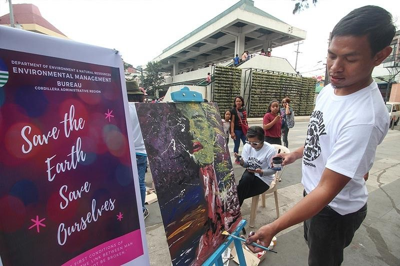 BAGUIO. Baguio-based artists depict Mother Earth in their art during a Department of Environment and Natural Resources-spearheaded