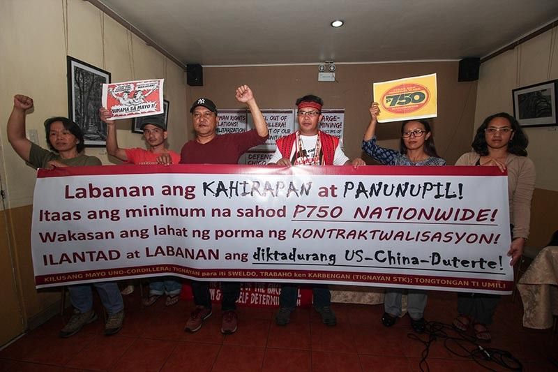 BAGUIO. Groups in the Cordillera call for a higher minimum wage during the celebration of Labor Day. (Jean Nicole Cortes)