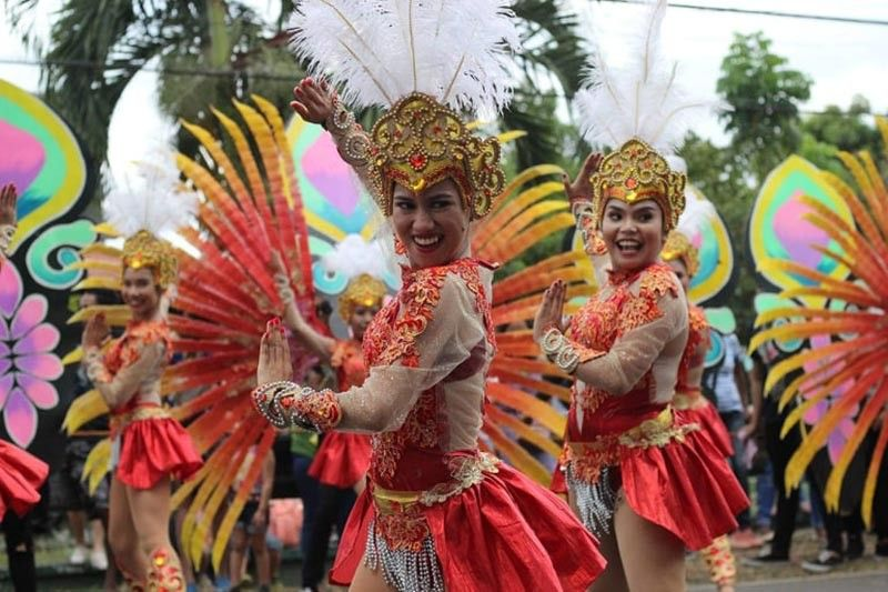 NEGROS. See the beautiful faces and dances by Pasalamat festival performers during the 40th Pasalamat festival in La Carlota City. (Photo by Mangkas Tribune, La Carlota City Government)