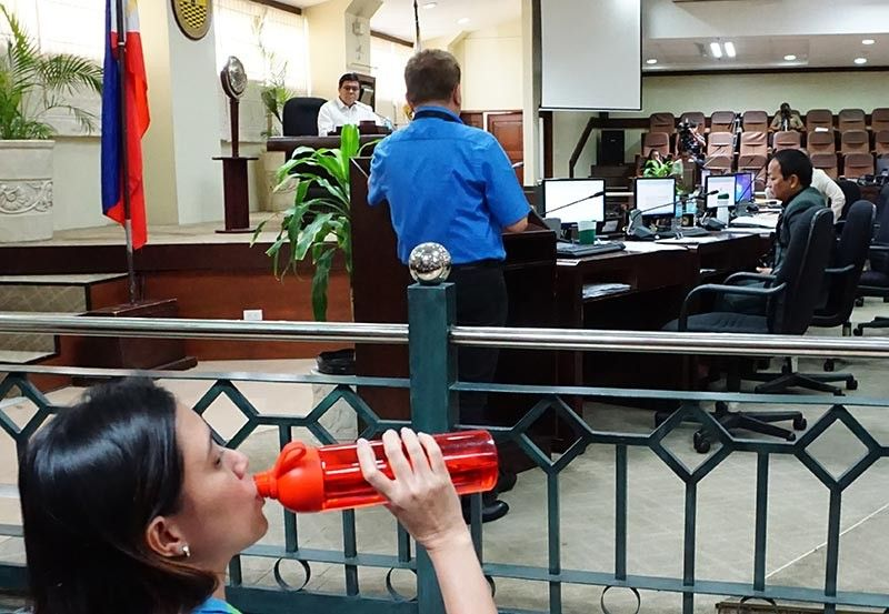 SAFE TO DRINK. MCWD spokesperson Charmaine Kara drinks water from MCWD's tap during an executive session called by the Cebu City Council to address the water problem. (SunStar Photo/Alex Badayos)