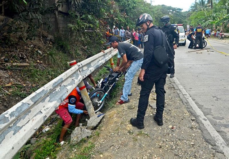 CEBU. Hours after the operation that killed Cebu's most wanted person, Gerly Luwage, in Cebu City, Police Master Sergeant Junard Cinco, who had built the case against him, was shot dead on a Toledo City Highway on April 30. (Alan Tangcawan)