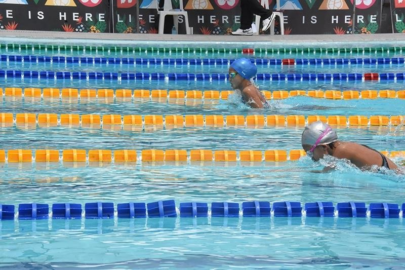 DAVAO. Liaa Margarette Amoguis, left, admits being distracted in her Breaststroke as she settled for the silver medal instead in elementary girls 200-meter individual medley event of the Palarong Pambansa 2019 swimming competition at the Davao City-University of the Philippines (UP) Sports Complex Aquatics Center Wednesday, May 1, 2019. (Marianne L. Saberon-Abalayan)