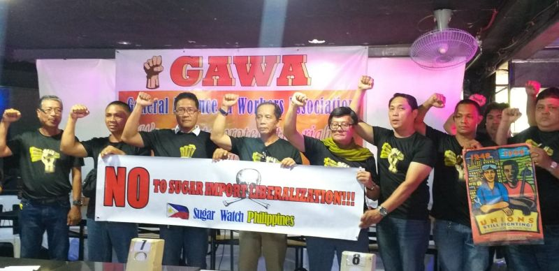 BACOLOD. Labor groups in Negros Occidental led by labor representatives Wennie Sancho (fifth from left) and Hernane Braza (fourth from left) during the Labor Day Forum held at Gerald's Restobar in Bacolod City Wednesday, May 1, 2019. (Erwin Nicavera)