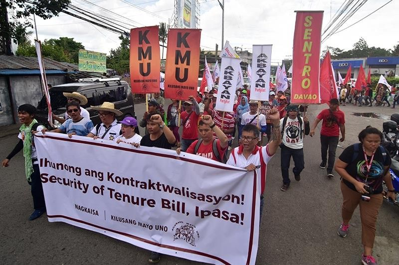 DAVAO. Several labor and union groups march around Davao City's main roads during their Labor Day protest Wednesday, May 1, calling for the end of contractualization in the country. (Macky Lim)