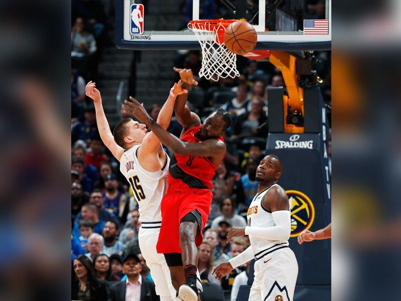 Denver Nuggets center Nikola Jokic, left, fights for control of a rebound with Portland Trail Blazers forward Al-Farouq Aminu during the first half of Game 2 of an NBA basketball second-round playoff series Wednesday, May 1, 2019, in Denver. <B>(AP Photo)</B>