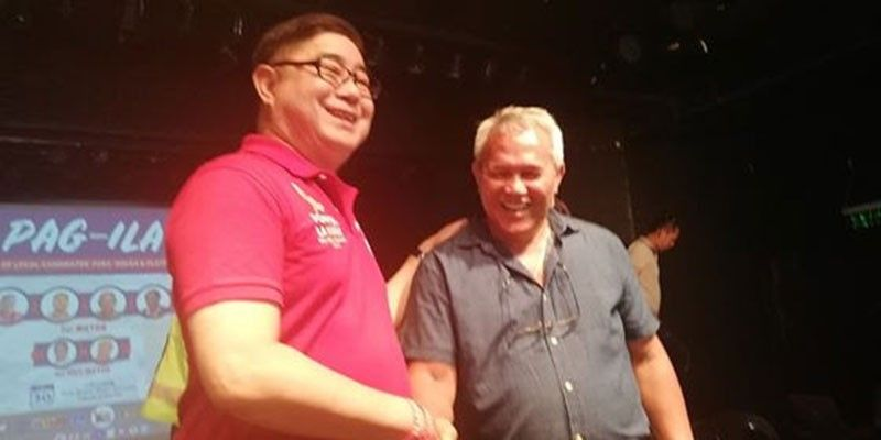 """Mayoral candidates Jose Gabriel """"Pompee"""" La Viña and Mayor Oscar Moreno in light moments during the Xavier University-initiated debate for candidates. (PJ Orias)"""
