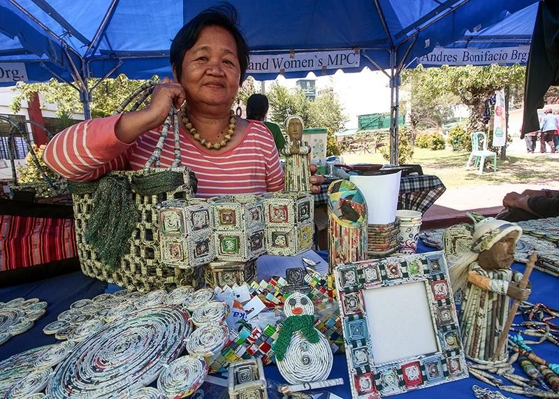 BAGUIO. Vicky Macaraeg, secretary of the Highland Women's Cooperative displays hand crafted recycled products at the Baguio City National High School (BCNHS) on Labor Day, May 1. (Jean Nicole Cortes)