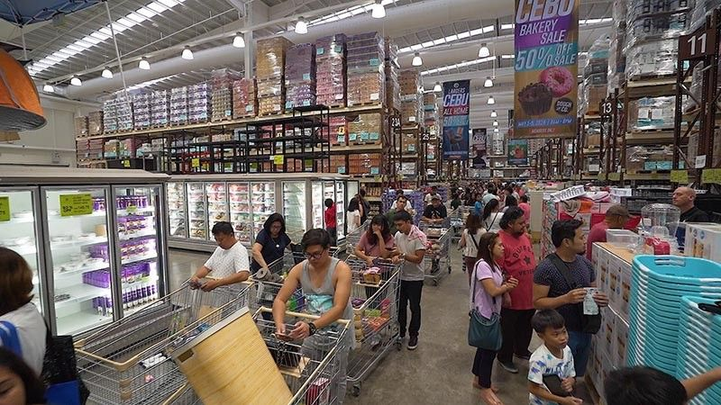 EXTRA HANDS FOR BUSY DAYS. It takes three weeks to prepare for a three-day sale at Landers Superstore, says assistant vice president for membership Frances Carreon. (Contributed photo)