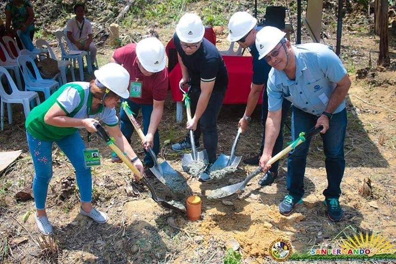 "A LOT FOR HEALTH. Stakeholders lay the time capsule for a new health station in Cabatbatan, San Fernando, from left (with hard hat): DOH Central Visayas development management officer Alma Ludalin Naboya, municipal health officer Dr. Alfredo Manugas VI, municipal administrator Ricci Regen Reluya, Councilor Philip Jude ""PJ"" Medalla, SEDC community relations officer Gines Boltron and (those without hard hat) officials of Cabatbatan led by Barangay Councilor Felix Benigra. (Contributed photo)"