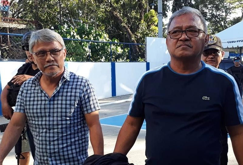 TEMPORARY LIBERTY. San Francisco, Camotes Mayor Aly Arquillano (right) and his brother Vice Mayor Alfredo Jr. are released on P750,000 bail. The two were charged with illegal possession of explosives and illegal possession of  firearms and ammunition. (SunStar file)