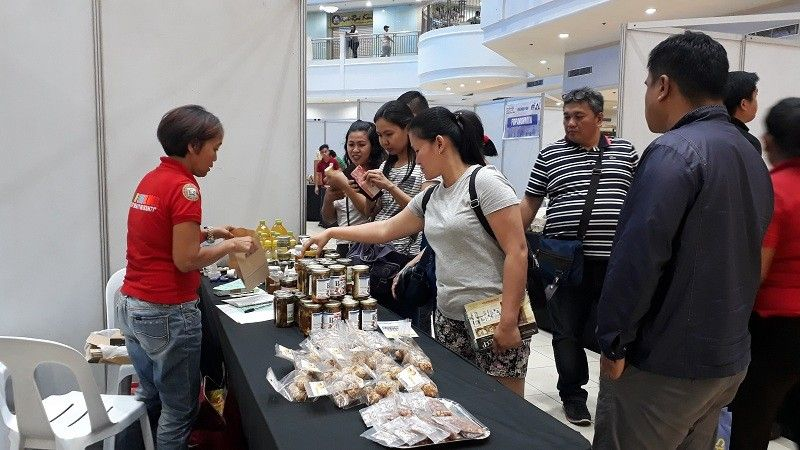 CAGAYAN DE ORO. Prospective buyers check local products from an exhibitor as the job fair in Limketkai Atrium is ongoing on Wednesday, May 1. The Department of Trade and Industry sidelines with Department of Labor and Employment's celebration of 117th Labor Day, with their two-day business fair. (Jo Ann Sablad)