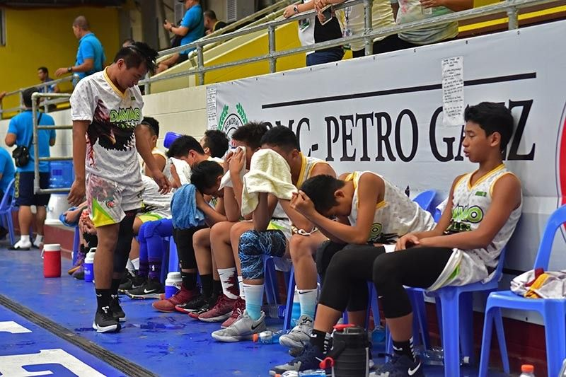 DAVAO. Members of the Davao Region Athletic Association (Davraa) elementary boys basketball team, unbeaten in the elimination round, react to their 55-61 loss to Calabarzon region in Friday's (May 3) Palarong Pambansa 2019 semifinals held at the Rizal Memorial Colleges Petro Gazz Arena. (Macky Lim)