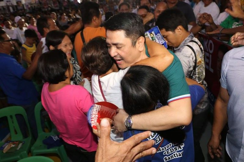 "PAMPANGA. Congressman Aurelio ""Dong"" Gonzales Jr. (3rd District of Pampanga) gets a kiss and hug from one of thousands of supporters during Friday's PDP Laban National Campaign sortie / caucus held at the BZG Convention Center, CSFP. The event was attended by senatorial candidates of PDP Laban. (Chris Navarro)"