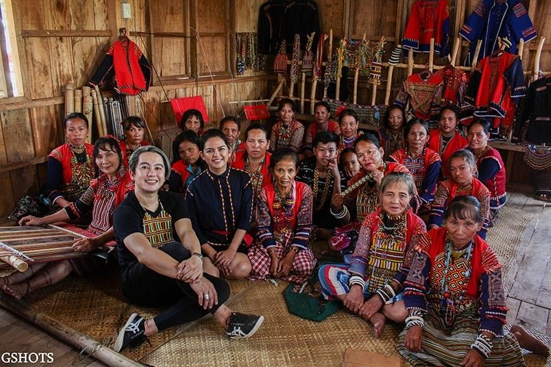 DAVAO. Philippine Women's College of Davao Program Chair for Fashion Design and Industrial Design Emi L. Englis and Davao de Oro fashion designer Cheri-Lou Rabanoz-Aranjuez with the beadweavers of the Mandaya tribe in barangay Andap in New Bataan, Davao de Oro. (Contributed Photo)