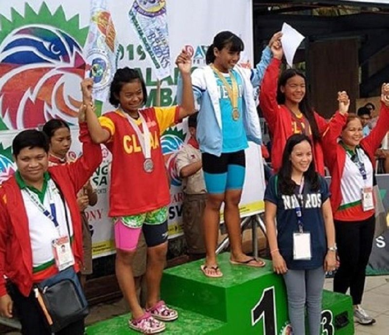 DAVAO. Alexie Kouzenye Cabayaran receives the gold medal in the Girls 12 & under 100 LC Meter Backstroke Elementary Girls with Central Luzon's bets as runners-up. (Photo by Maria Jenny Padronia Orcajada)