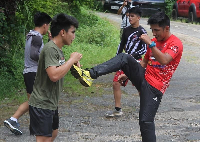 BAGUIO. Geje Eustaquio spars with ONE strawweight world champion Joshua Pacio as he starts his build up for an alternate bout for the ONE Flyweight World Grand Prix on May 17. (Photo by Roderick Osis)