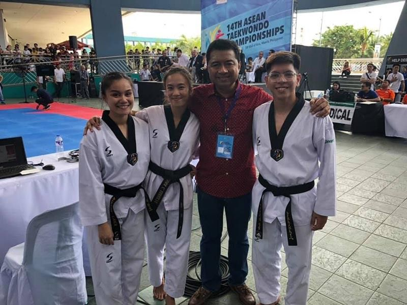 WINNERS. PTA 7 Regional Chairman Tony del Prado poses with Cebuano jins (from left) Aidane Laxa, Rinna Babanto and McAvynger Alob during the 14th Asean Taekwondo Cham-pionships. (Contributed photo)