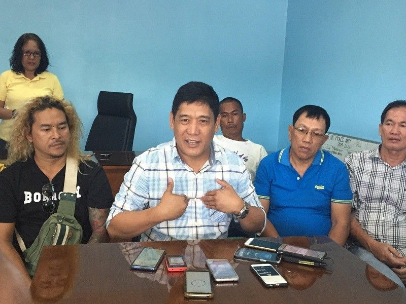BACOLOD. Village chief Noli Villarosa of Barangay Tangub, Bacolod City with his 27 purok officials in a press conference in the barangay hall of said village on Monday, May 6. (Merlinda Pedrosa)
