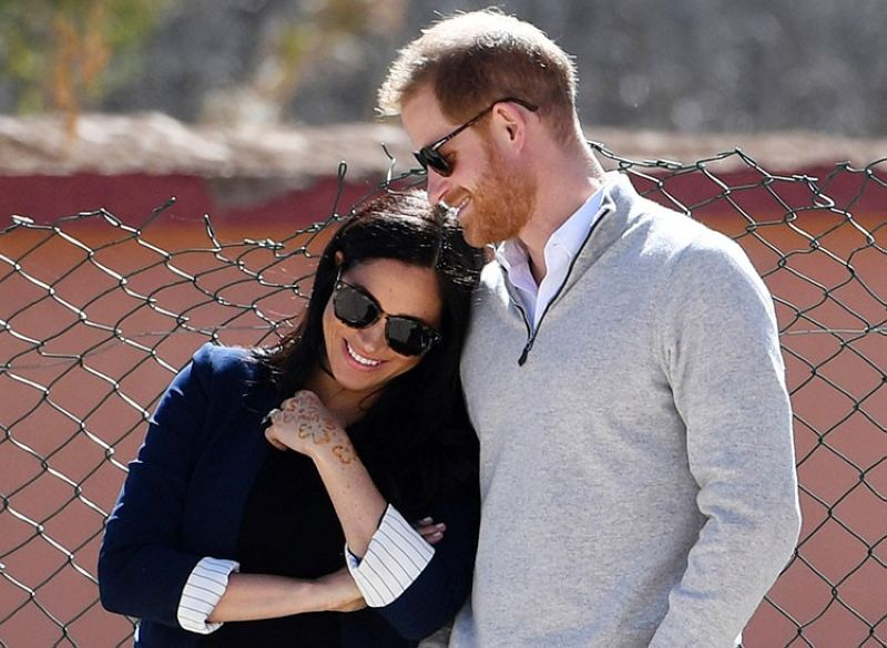 MOROCCO. In this February 24, 2019 file photo, Britain's Prince Harry and Meghan, Duchess of Sussex, watch children playing football at a school in the town of Asni, in the Atlas mountains, Morocco. (AP)