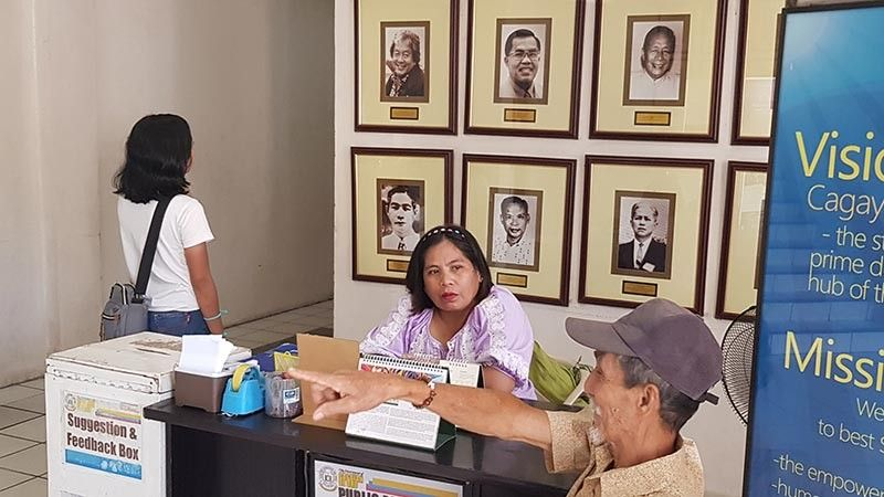 "CAGAYAN DE ORO. In the main lobby of Cagayan de Oro City Hall hangs a framed portrait of former mayor Vicente ""Dongkoy"" Y. Emano (upper corner left), along with other photographs of other former mayors. Emano passed away on Tuesday midnight, May 7, at the age of 76. (Nef Luczon)"