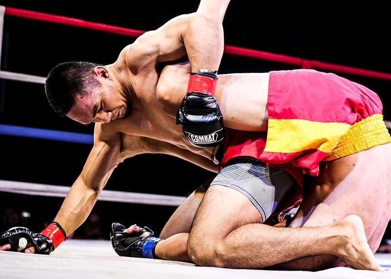 BAGUIO. Aaron Posawen from Cervantes, Ilocos Sur defeats Ugeanne Ignas from Buguias Benguet via referee stoppage due to ground and pound in the 1st Round of the 4th Team Lakay Kapangan Invasion Championships recently. (Photo by Jean Nicole Cortes)