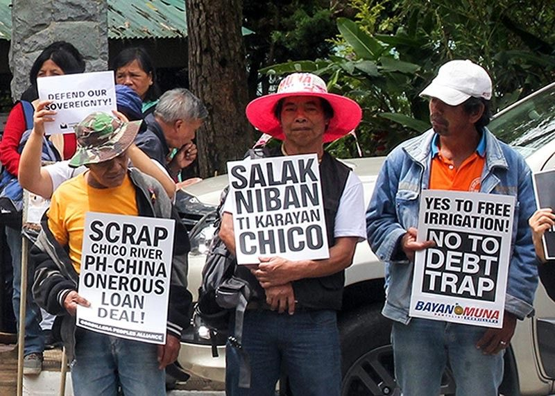 BENGUET. Militant groups rally in front of NEDA–CAR to protest against the ongoing construction of the China-funded Chico River Pump Irrigation Project in Kalinga province. (Photo by Jean Nicole Cortes)
