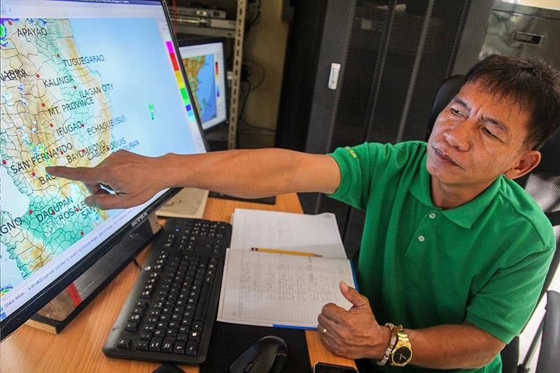 ILOCOS NORTE. Engineer Larry Esperanza, weather specialist stationed in PAG - ASA Baguio Station monitors the Doppler radar  forecast in Baguio City and nearby provinces on Tuesday morning. Esperanza explains the cloudy skies with rain showers and thunderstorms will continue due to the low pressure area coming from the north northwest of Laoag City, Ilocos Norte. (Photo by Jean Nicole Cortes)