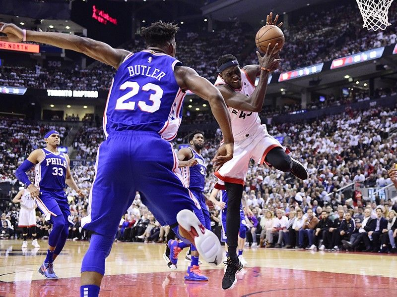 Toronto Raptors forward Pascal Siakam (43) is fouled by Philadelphia 76ers guard Jimmy Butler (23) during the second half of Game 5 of an NBA basketball second-round playoff series, Tuesday, May 7, 2019, in Toronto. <B>(AP)</B>