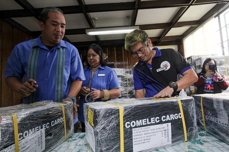 BAGUIO. Commission on Elections (Comelec) and Baguio City Hall officials inspect the 235 ballots delivered at the city hall on May 8 to make sure the ballot identification number match. (Photo by Jean Nicole Cortes)
