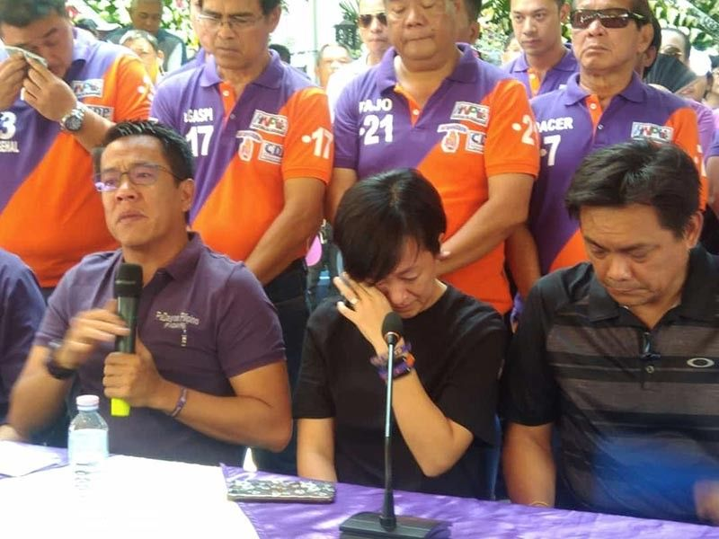 """CAGAYAN DE ORO. Last-termer City Councilor Nadya Emano-Elipe (center), casually wipes her tears as her brother, (left) Misamis Oriental Governor Yevgeny Emano, announces that their local political party, Padayon Pilipino, chooses her to replace former Cagayan de Oro mayor Vicente """"Dongkoy"""" Emano as candidate for vice mayor in the May 13 polls. Nadya accepts the party's decision a day after their father, the elder Emano, died on Tuesday, May 7. (Alwen Saliring)"""