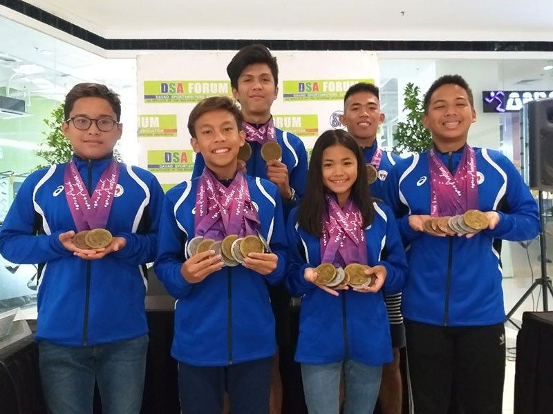 DAVAO. Arafura Games 2019 champions Ray Martin Yarra, Ivo Nikolai Enot, Lora Micah Amoguis, Mark Anthony Caseñas and Joshua Raphael Del Rio of Davao City show their medals after guesting in yesterday's Davao Sportswriters Association Forum at The Annex of SM City Davao. (Marianne L. Saberon-Abalayan)