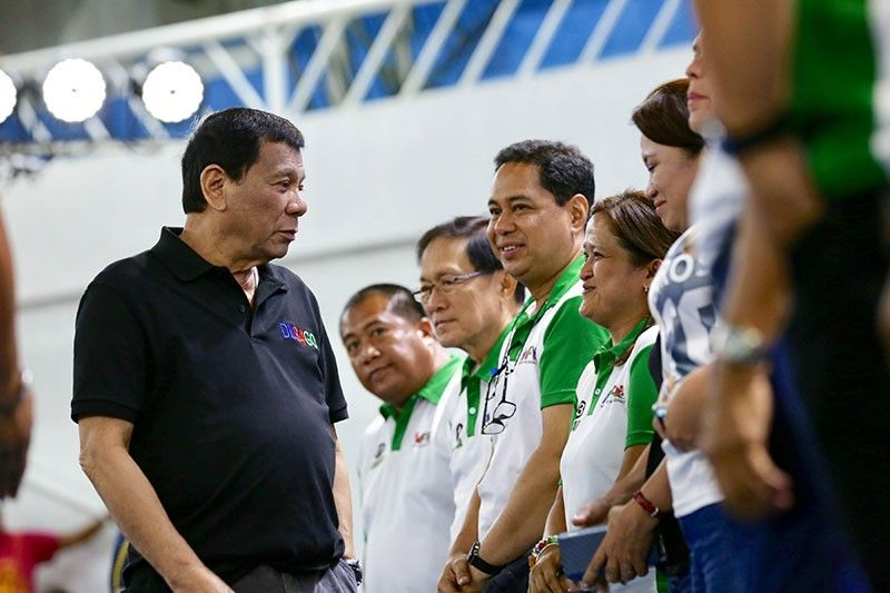 DAVAO. President Rodrigo Roa Duterte discusses matters with some of the local candidates of Davao City during the Hugpong ng Pagbabago-Hugpong sa Tawong Lungsod (HNP-HTL) campaign sortie at the Davao City Recreation Center on May 10, 2019. (Richard Madelo/Presidential photo)
