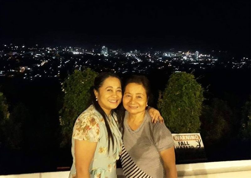 DAVAO. The writer with her mother, Aleli Saberon, in a restaurant in Cagayan de Oro City. (Contributed photo)