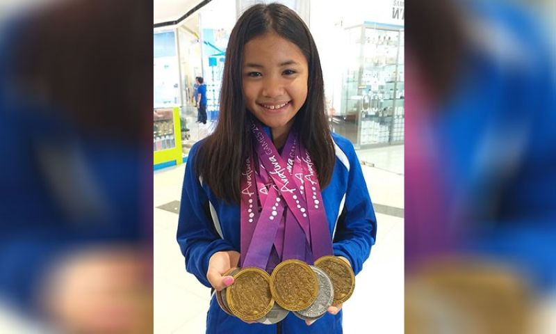 DAVAO. Dabawenya swimmer Lora Micah Amoguis, 13, shows the three gold medals, five silvers and one bronze she won in the recently concluded Arafura Games 2019 held in Darwin, Northern Territory, Australia after the Davao Sportswriters Association Forum held last Thursday, May 9, at The Annex of SM City Davao. (Marianne L. Saberon-Abalayan)